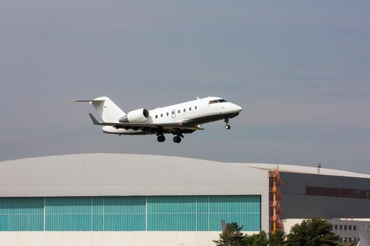 Jet_over_hangar