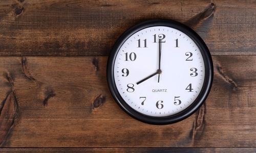 Clock_on_wood_planks_edited