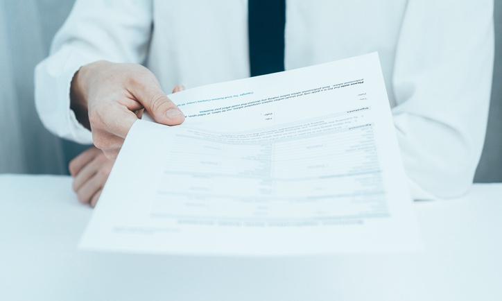 Handing_paperwork_over_edited