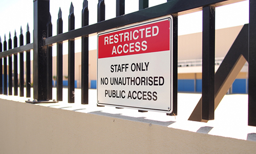 Restricted_Access_sign_on_fence_edited