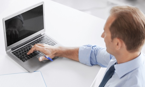 Male_laptop_blueshirt_securitypage