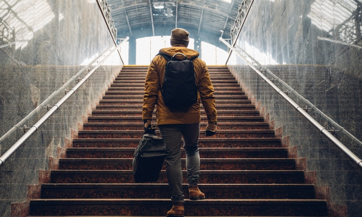 Man_going_up_steps_with_luggage_edited