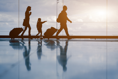 family_walking_airport